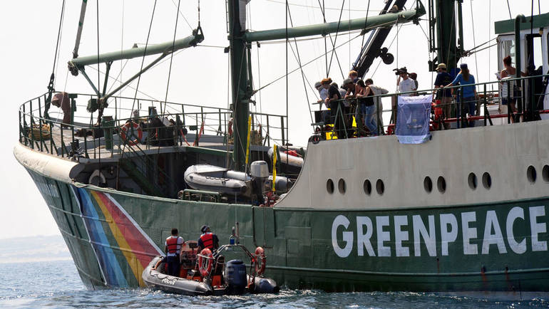 "Israeli police arrested 14 Greenpeace activists protesting Israel's plan to build an electricity power plant fueled by coal on Monday September 8, 2008. Police moved in after activists on the Greenpeace flagship ""Rainbow Warrior"" spray-painted a slogan.."